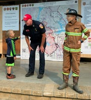 Steve Spinharney, Cal Fire deputy incident command trainee, spends a little time out of his busy day speaking with Carter and Kenny Garrison of Anderson.