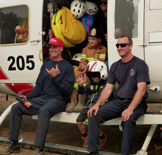Brothers Kenny and Carter Garrison had quite a day as they visited firefighters Monday assigned to the Carr Fire.
