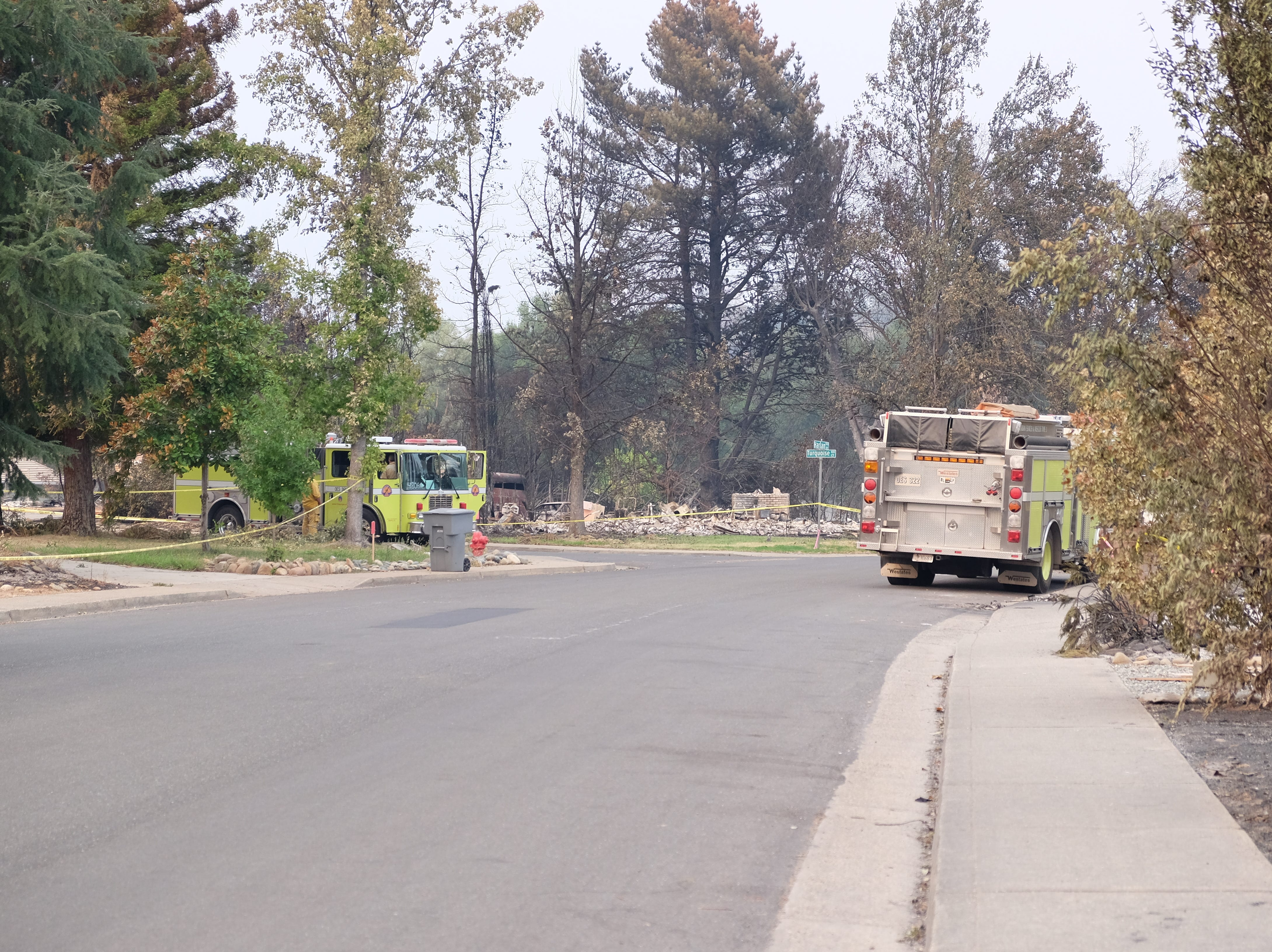 Fire crews patrol the neighborhood in Redding which saw widespread destruction from the Carr Fire.