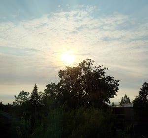 Sun shines through a hazy sky Monday morning in Salem.