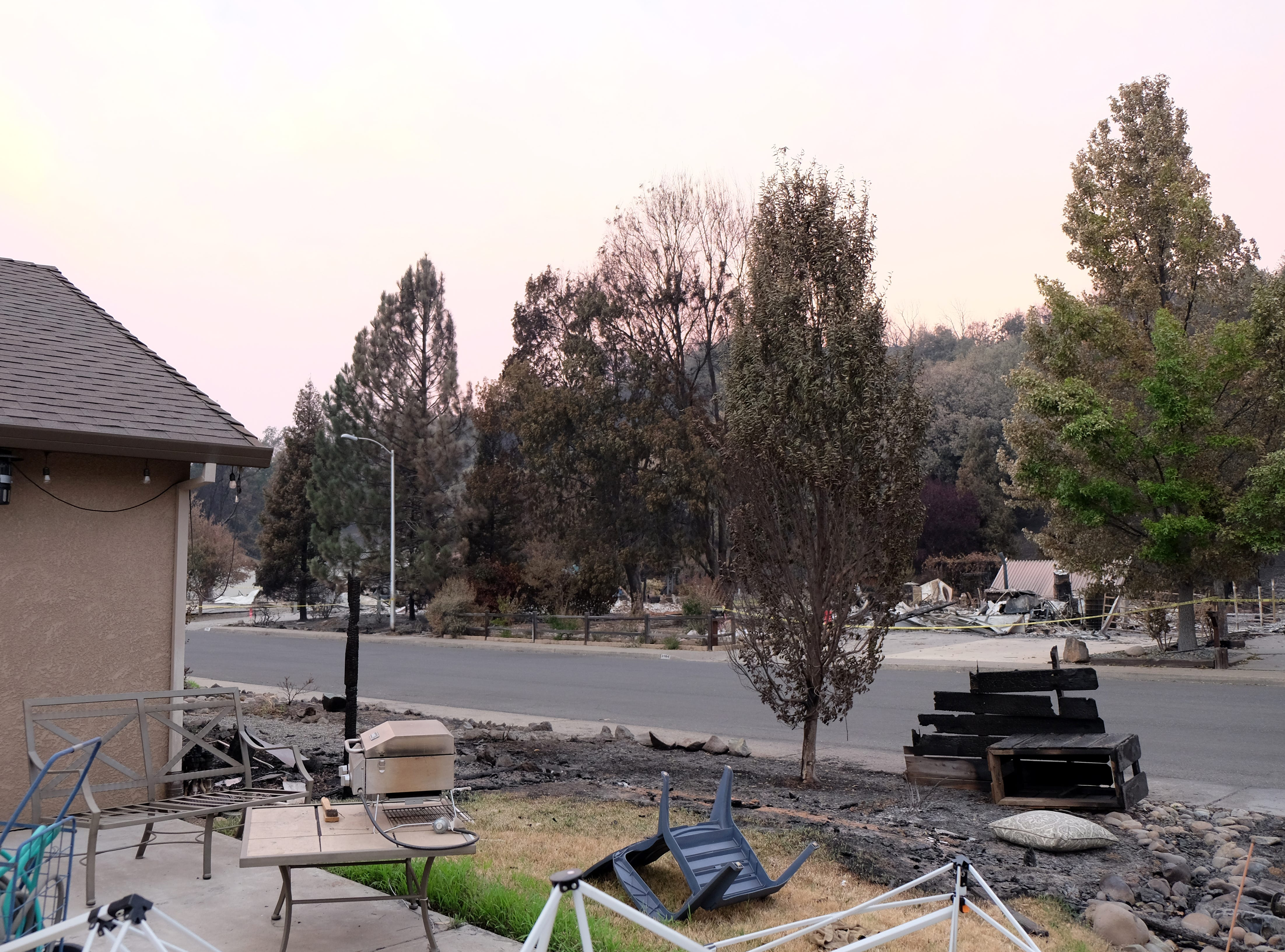 A view of burned homes across the street from the Robinsons. Homes were leveled all around their Redding neighborhood.