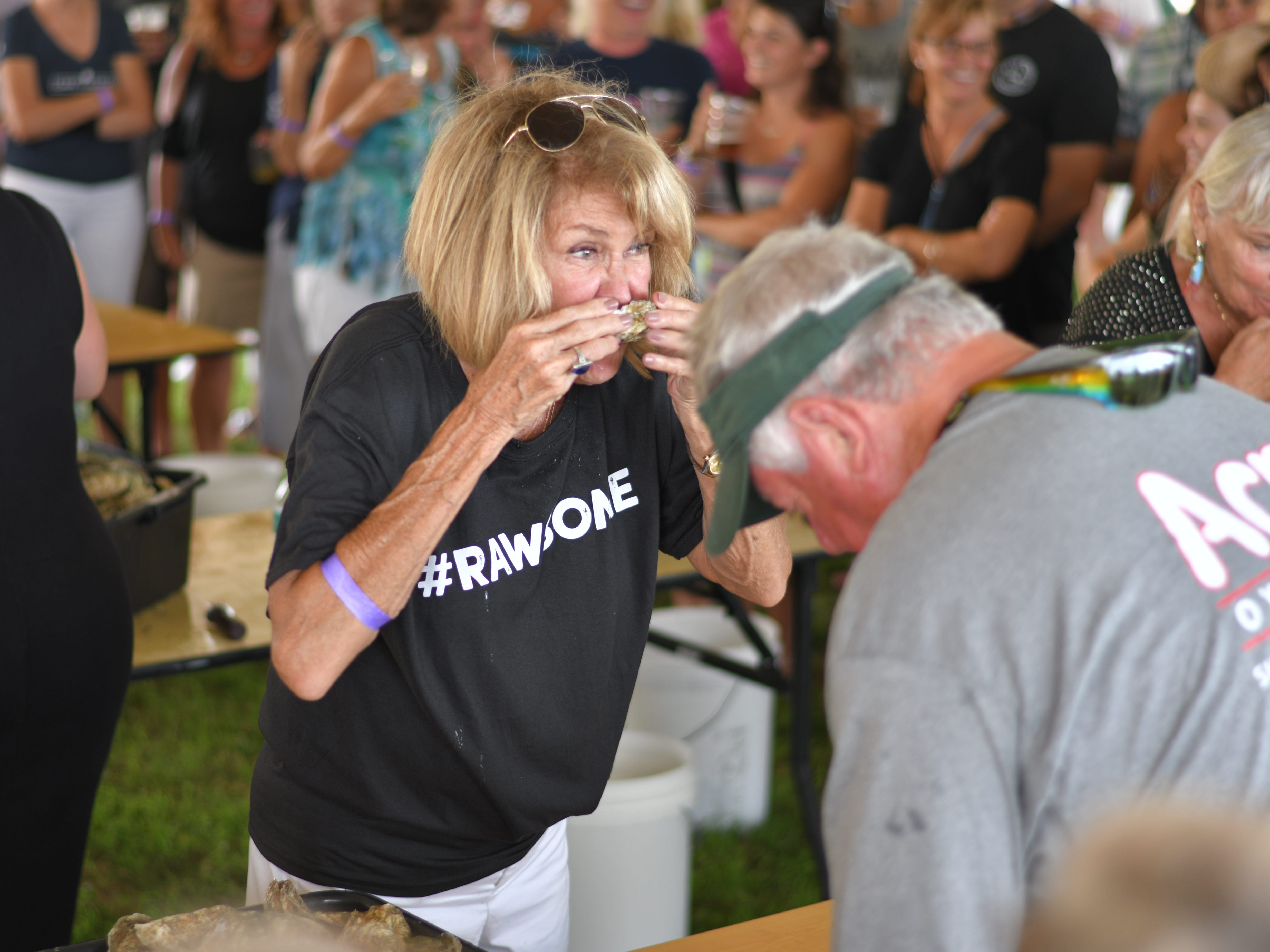 Mary Creekmore downs a raw oyster at the 3rd Annual Oyster Eating Contest.