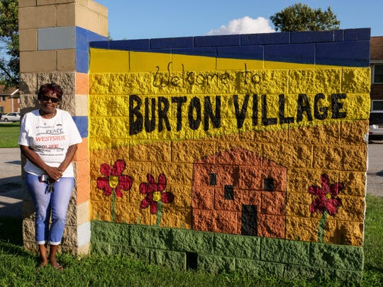 """Eleanor Marchtmon stands in front of Burton Village, where her son, Coley """"Pete"""" Marchtmon was brutally beaten by a group of men in July 2008. He died on August 4 of that year. Eleanor held her last peace march in his honor on Saturday, marking 10 years since her son died. The peace marches helped heal the community and prevent retaliation."""