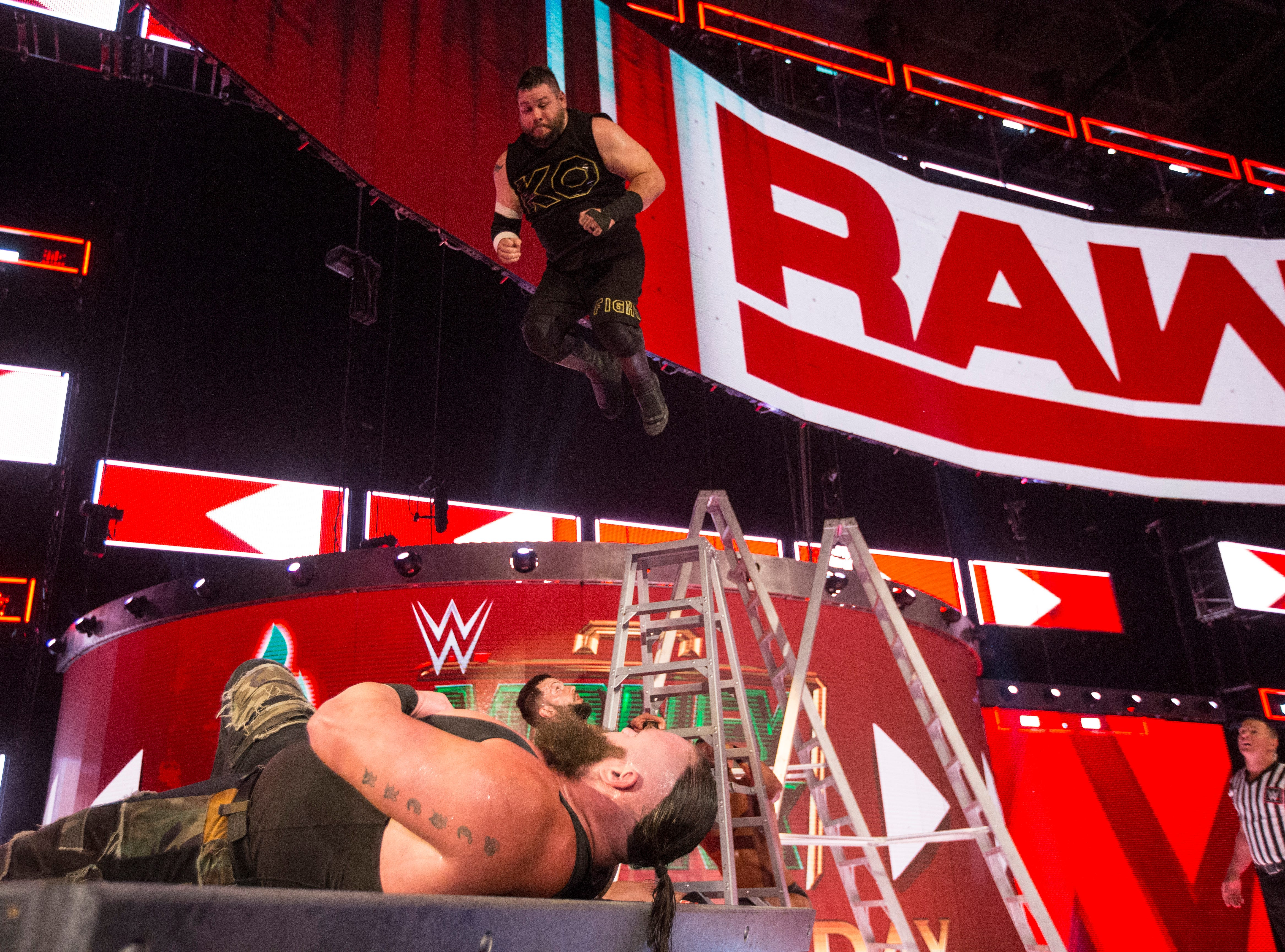Kevin Owens (jumping) is one of the WWE wrestlers expected to perform at the Wicomico Youth & Civic Center on Friday, Aug. 10, 2018.