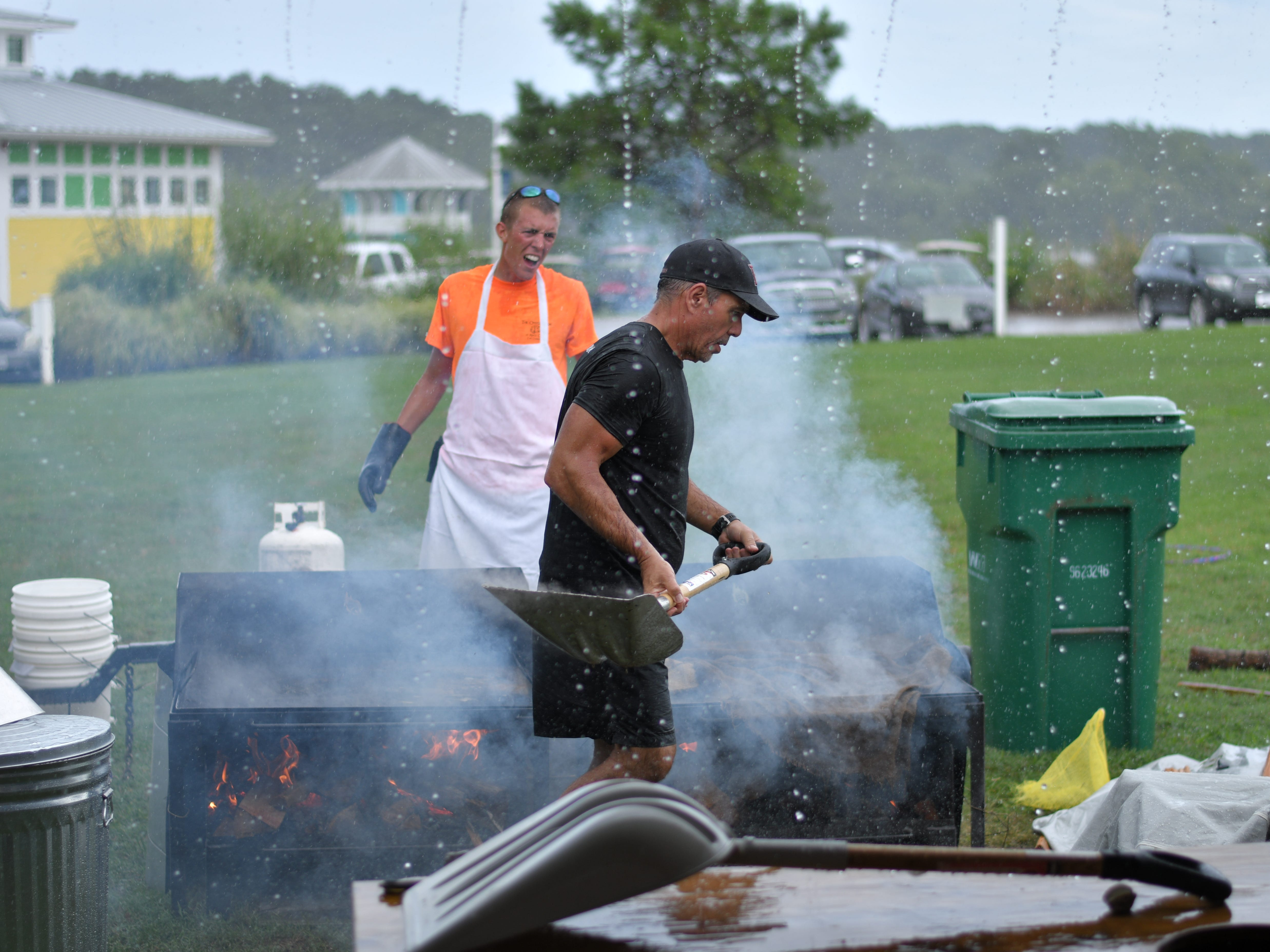 Staff member Neil Gylling works the steamer at the 3rd Annual Oyster Eating Contest on  Aug. 3.