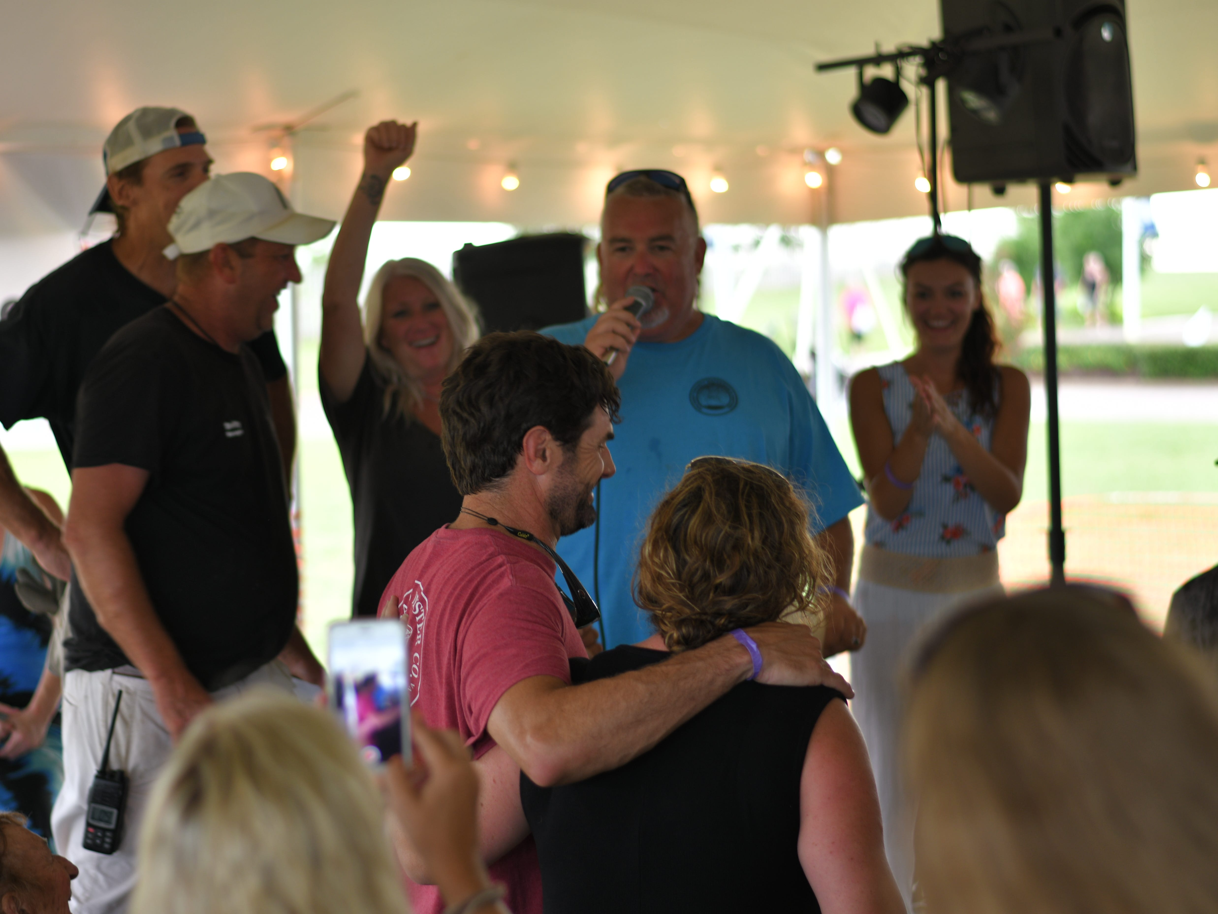 Chris Buck and Tiffany Mohr are pronounced first place winners after shucking and eating 108 raw oysters at the 3rd Annual Oyster Eating Contest at the Oyster Farm in Cape Charles.