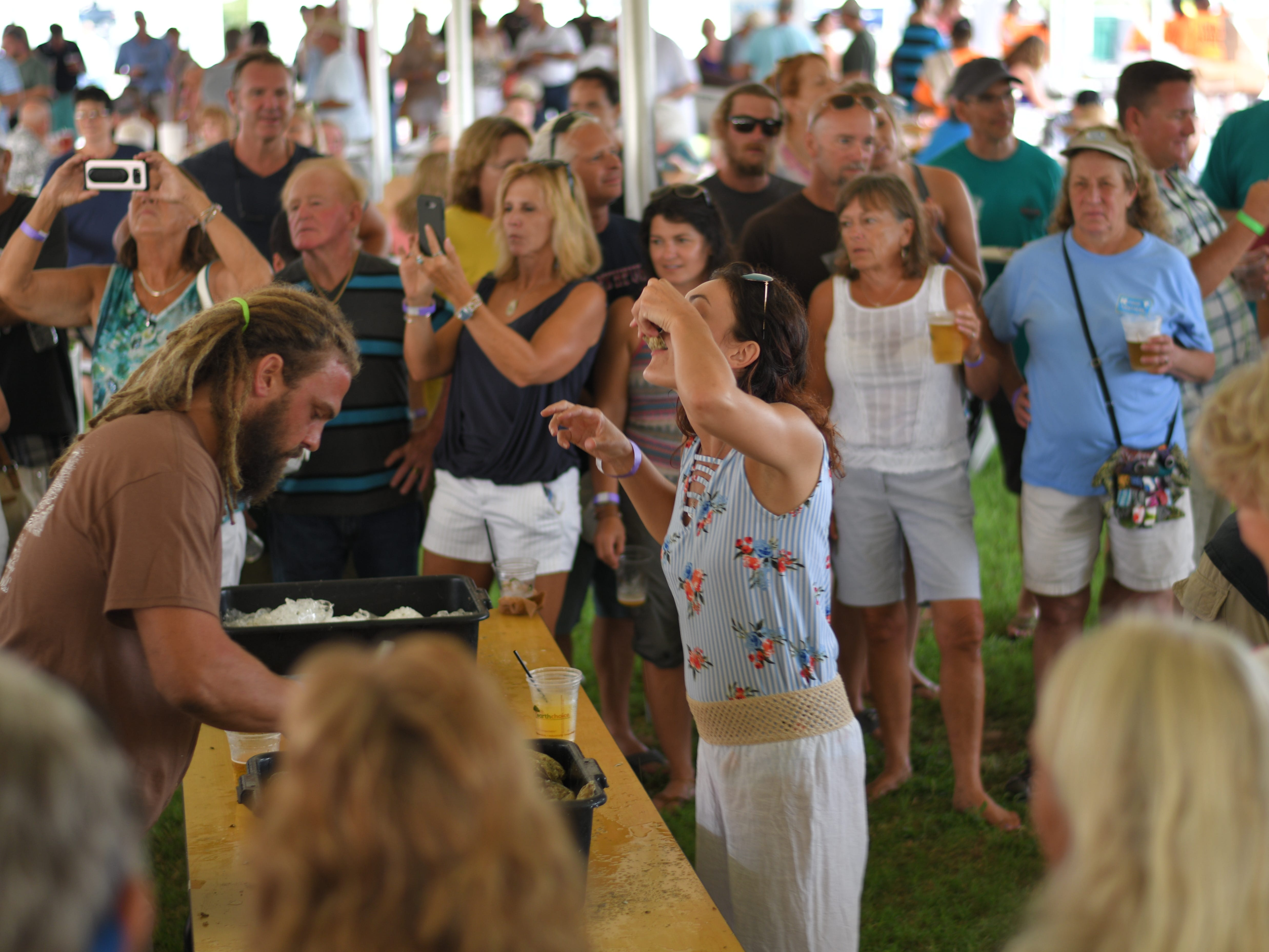 Rachel Savage downed 90 oysters with the help of Scott Wivell's shucking skills at the 3rd Annual Oyster Eating Contest.