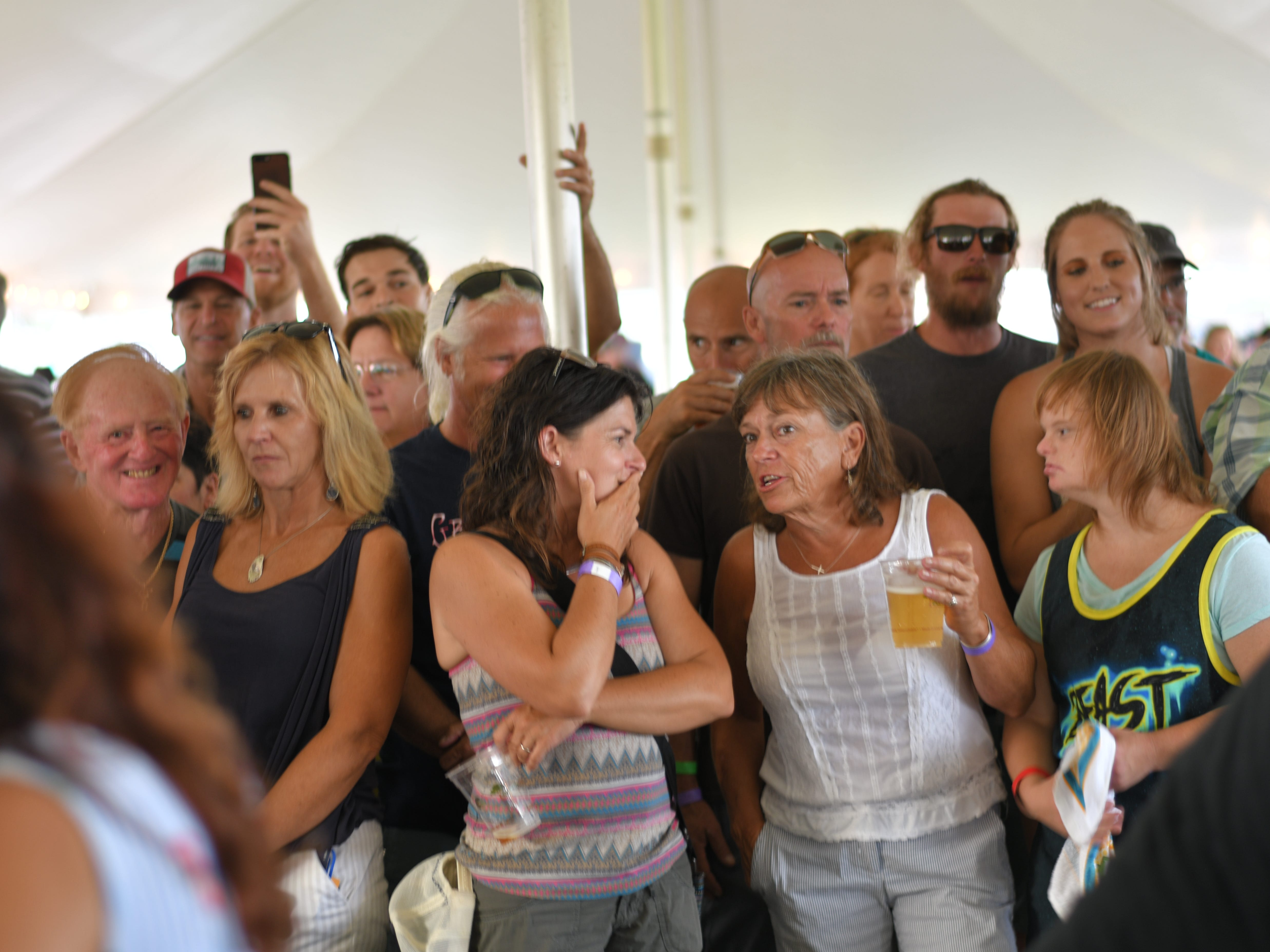 A crowd watches the contestants shuck and suck oysters at the contest in Cape Charles.