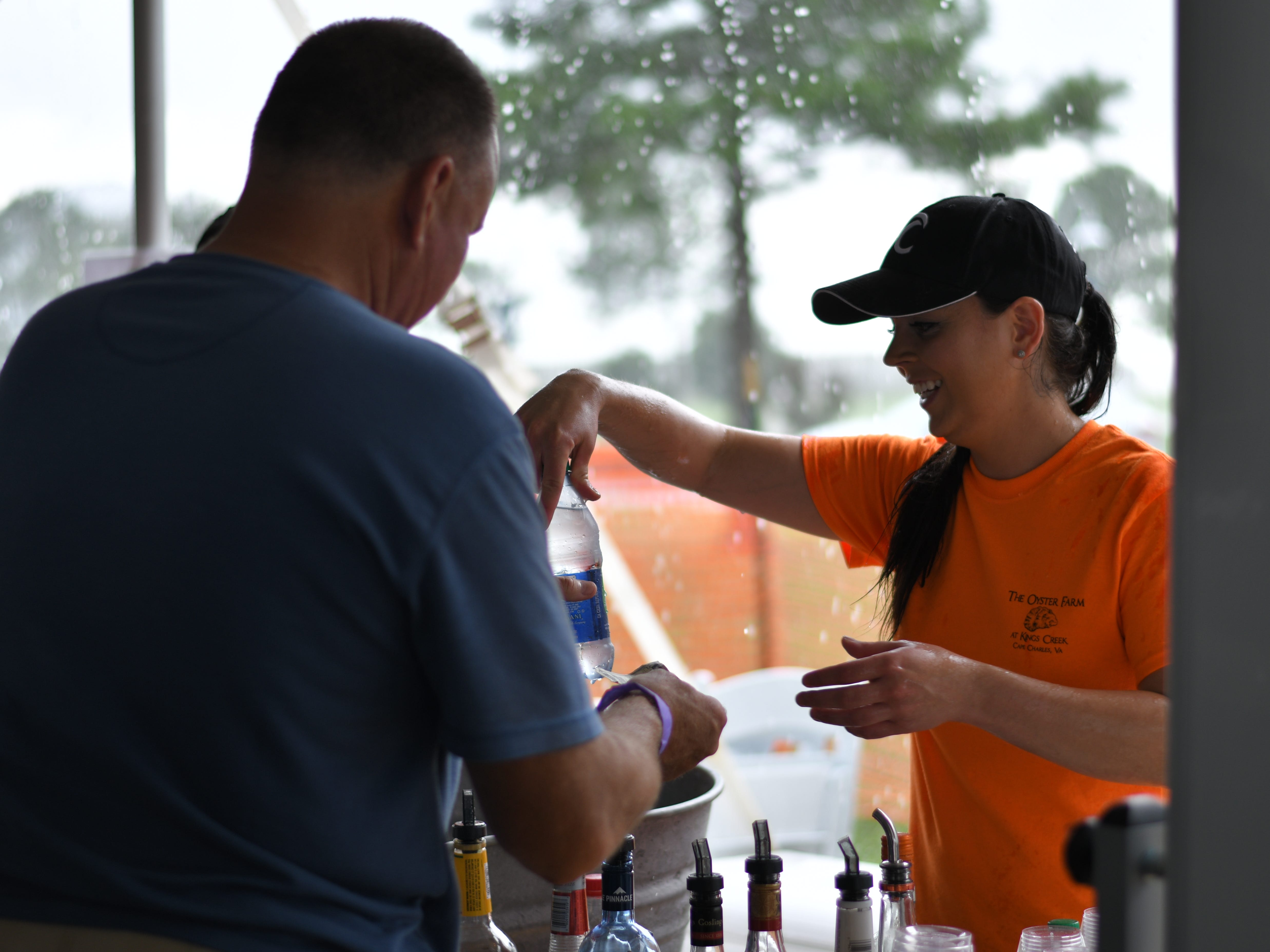 Casey May serves a customer at the 3rd Annual Oyster Eating Contest in Cape Charles.