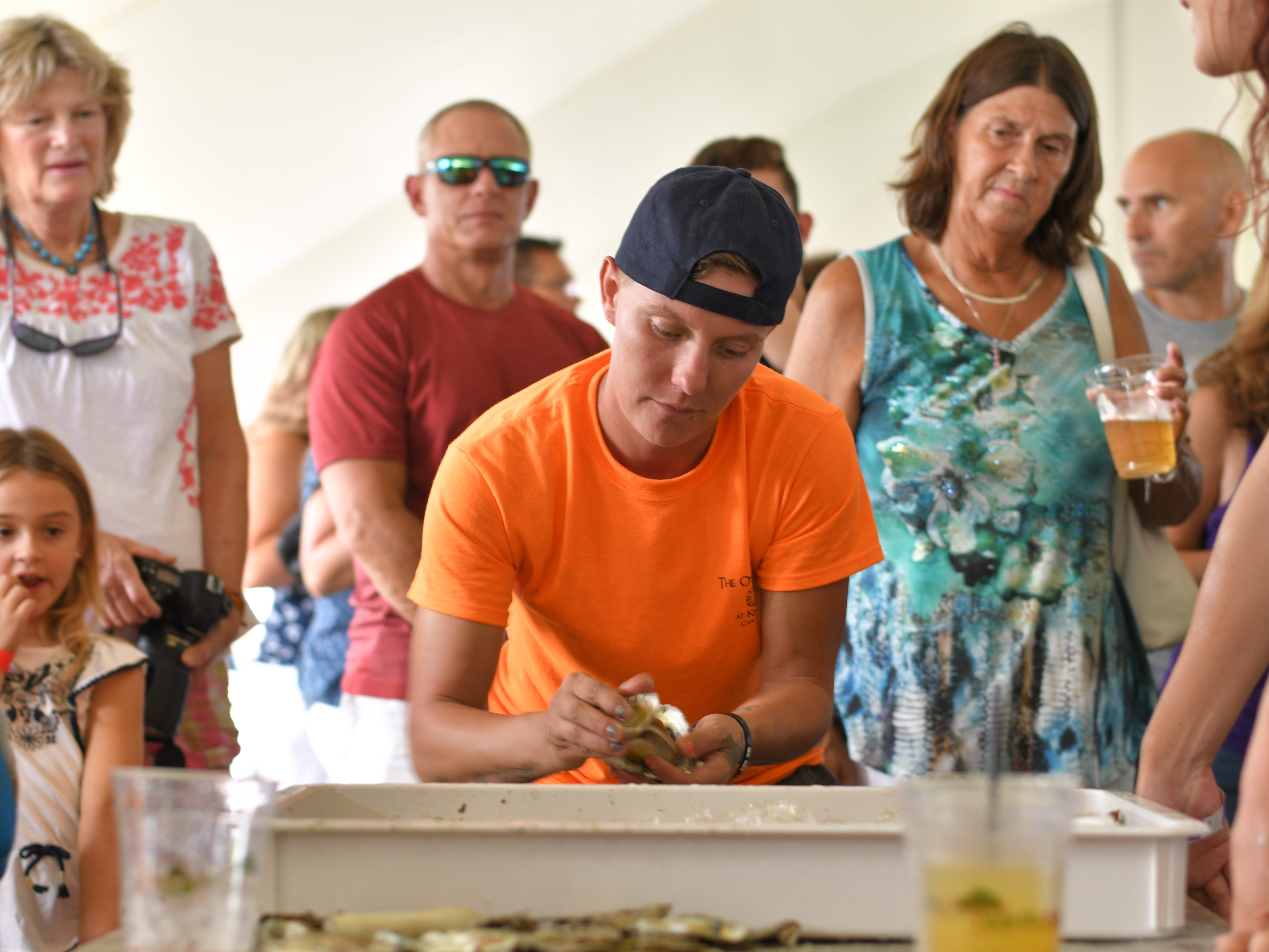 Casey May counts the number of oyster shells after the end of the 3rd Annual Oyster Eating Contest at the Oyster Farm in Cape Charles.