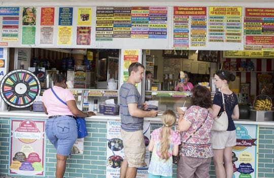 Customers wait for their ice cream outside The Ice Cream Store in Rehoboth Beach. KYLE GRANTHAM/THE NEWS JOURNAL