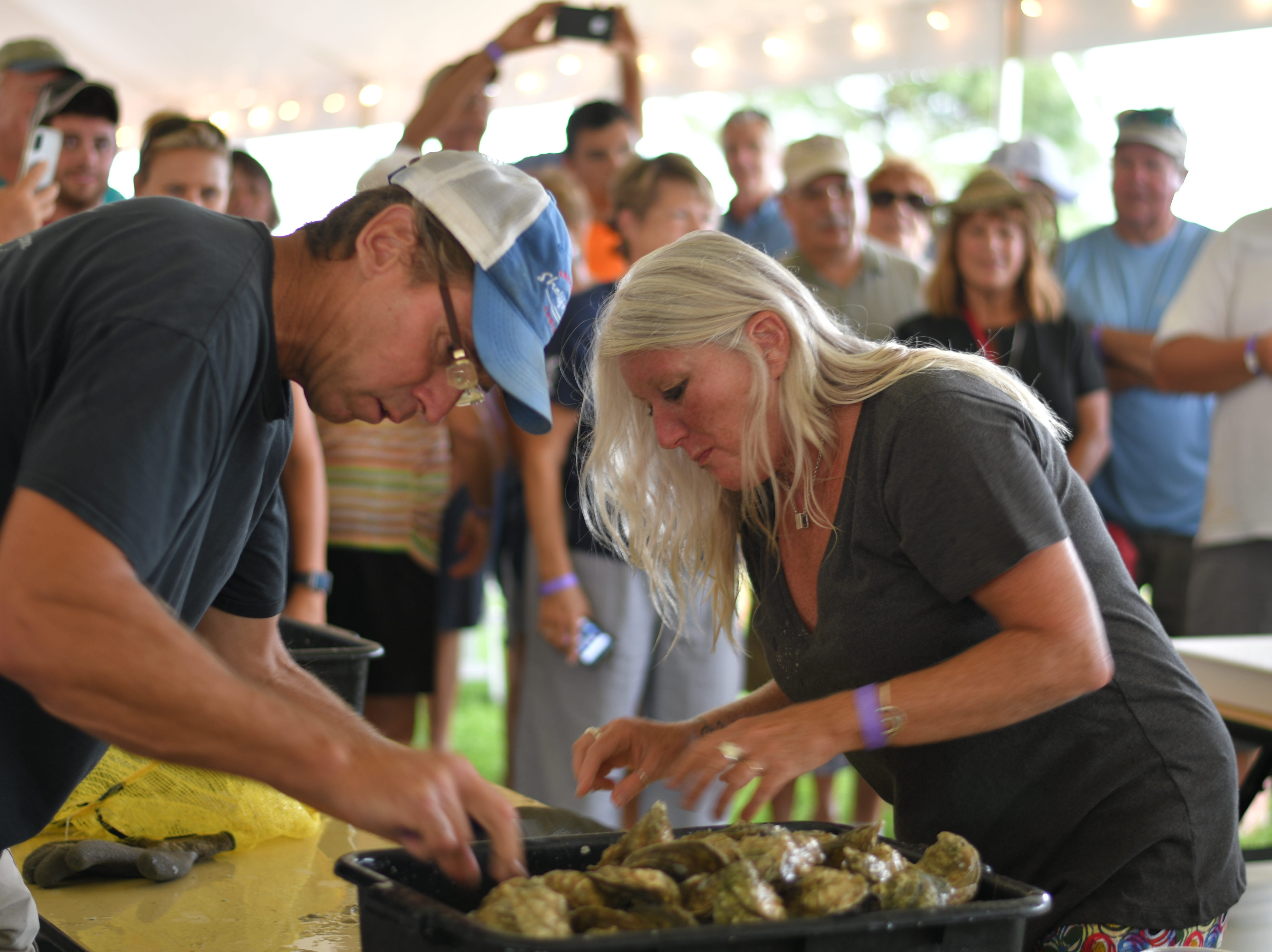 Joe Peirson and Sally Lewin won second place after shucking and eating 102 raw oysters at the 3rd Annual Oyster Eating Contest on Friday, Aug. 3, at Oyster Farm at King's Creek in Cape Charles.