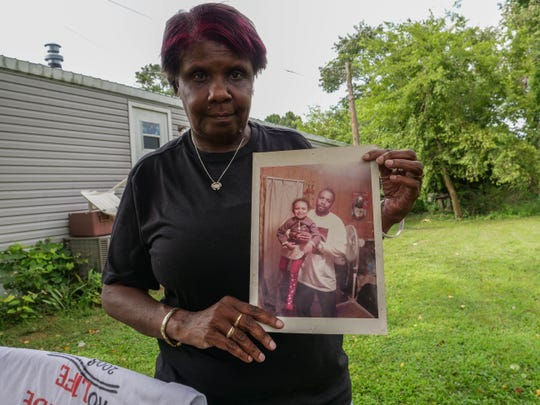 Eleanor Marchtmon holds up a photo of her son Coley Marchtmon, who died 10 years ago after being brutally beaten by a group of men in Burton Village while on his way home from work. She held her last peace march in his honor in West Rehoboth over the weekend.