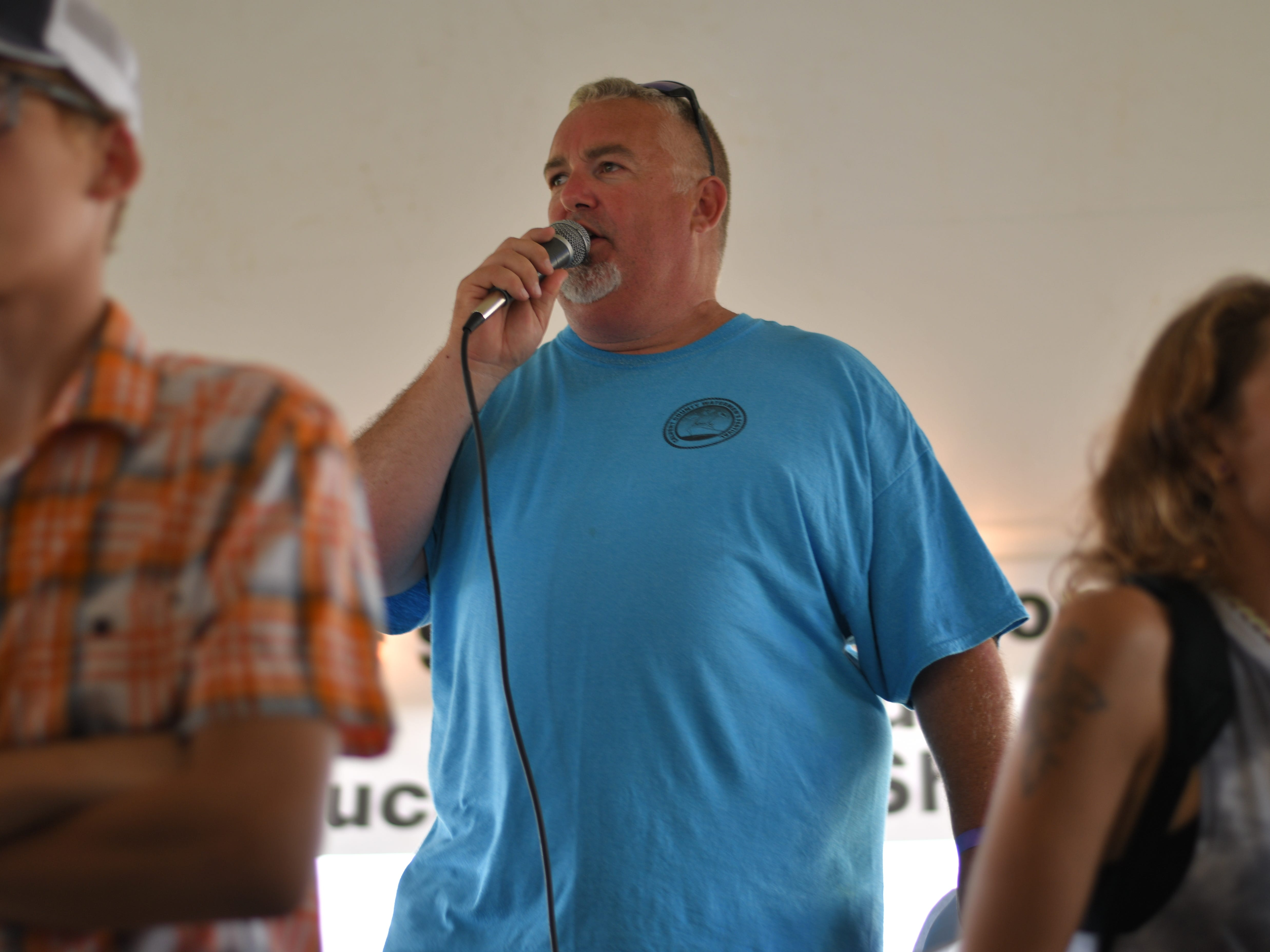 Announcer Flea Emily speaks at the 3rd Annual Oyster Eating Contest in Cape Charles.