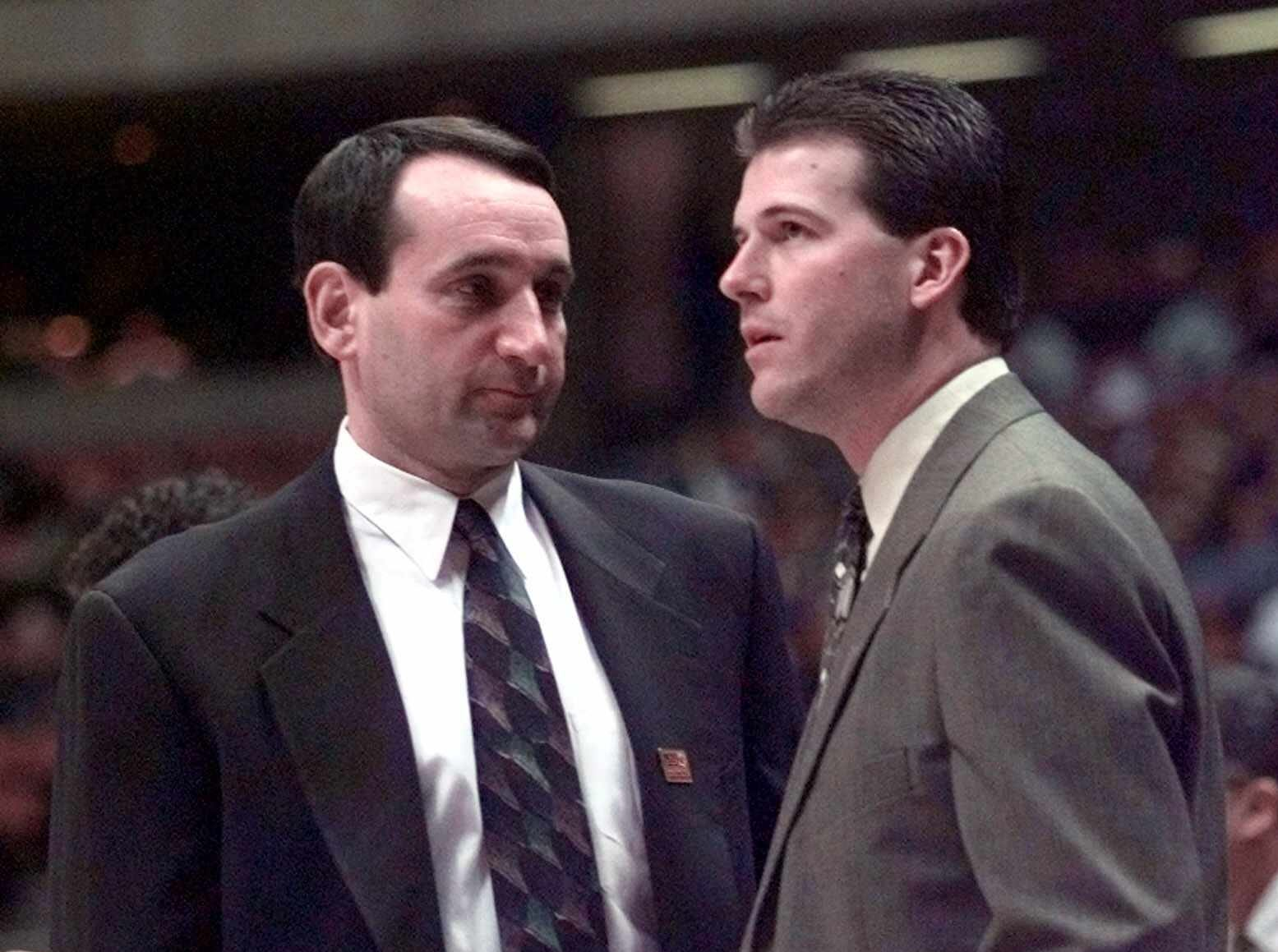 -  -Duke coach Mike Krzyzewski, left, and Southwest Missouri State coach Steve Alford talk before their East Regional Semifinal game in East Rutherford, N.J. Friday, March19, 1999. (AP Photo/Kathy Willens)