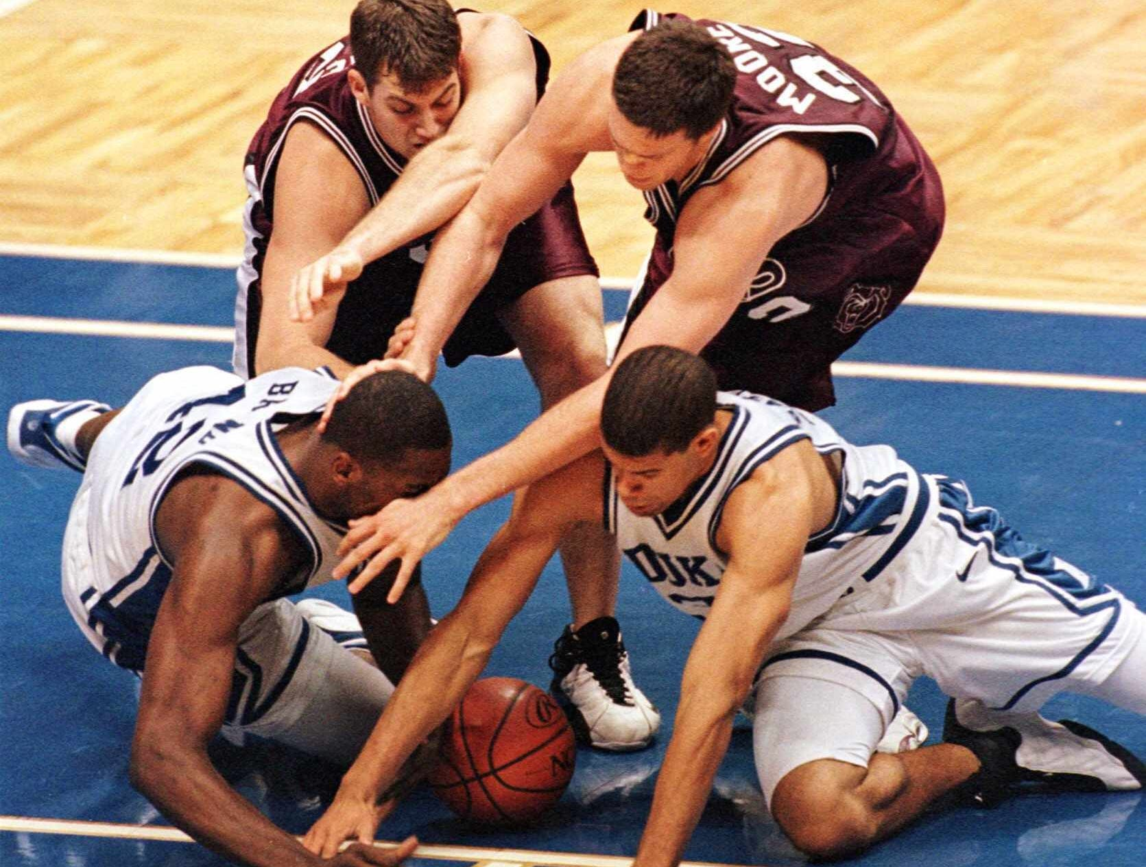 -  -Southwest Missouri State's Matt Rueter, left rear, teammate Danny Moore, right rear, Duke's Elton Brand, left, and teammate Shane Battier scramble for the ball during their East Regional semifinal game in East Rutherford, N.J. Friday, March 19, 1999. Duke defeated the Bears 78-61. (AP Photo/Bill Kostroun)