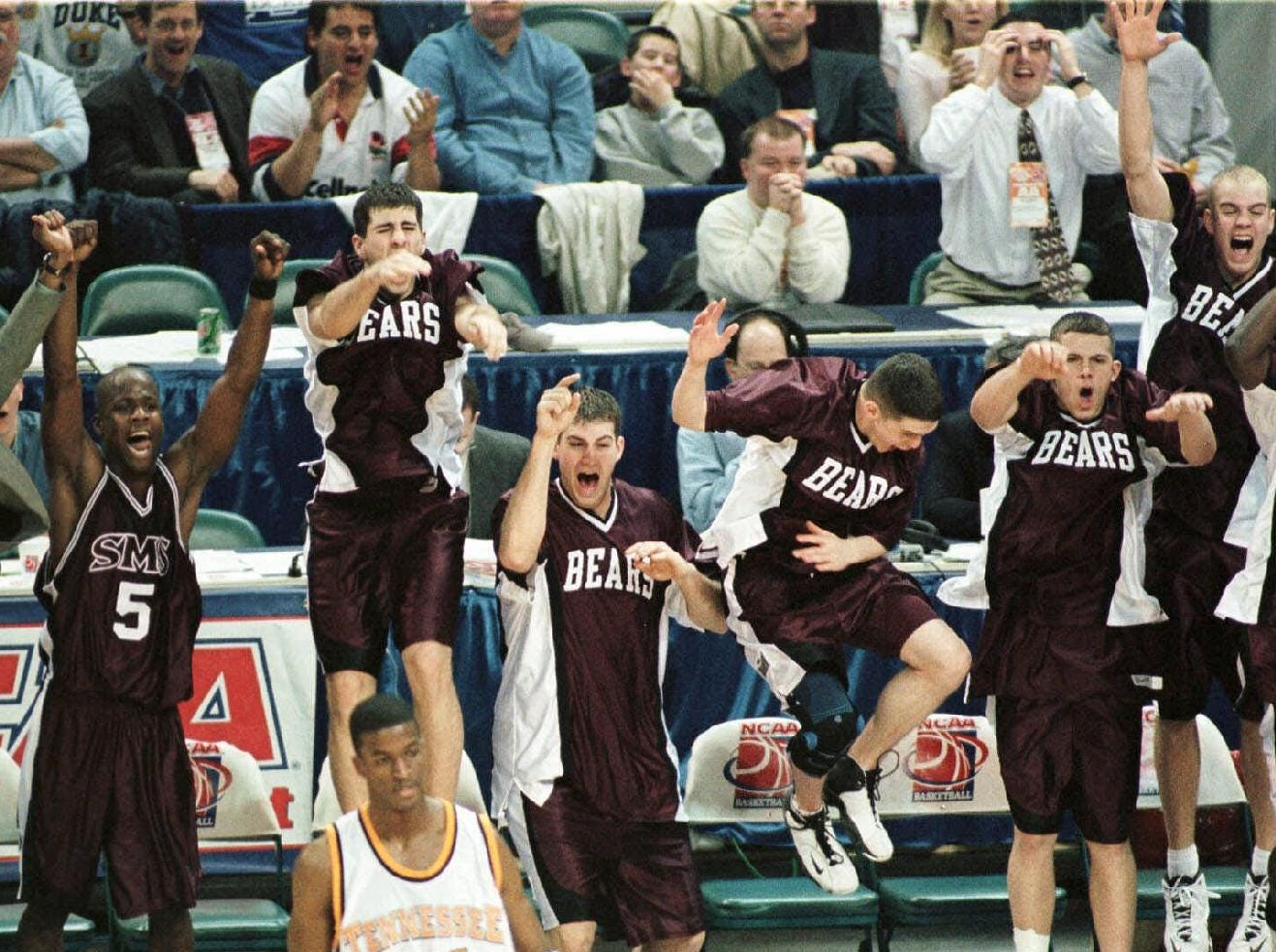 -  -Southwest Missouri State players erupt from the bench in the closing moments of their 81-51 win over Tennessee in the NCAA second round at the Charlotte Coliseum in Charlotte, N.C., Sunday March 14, 1999. (AP Photo/Rick Havner)