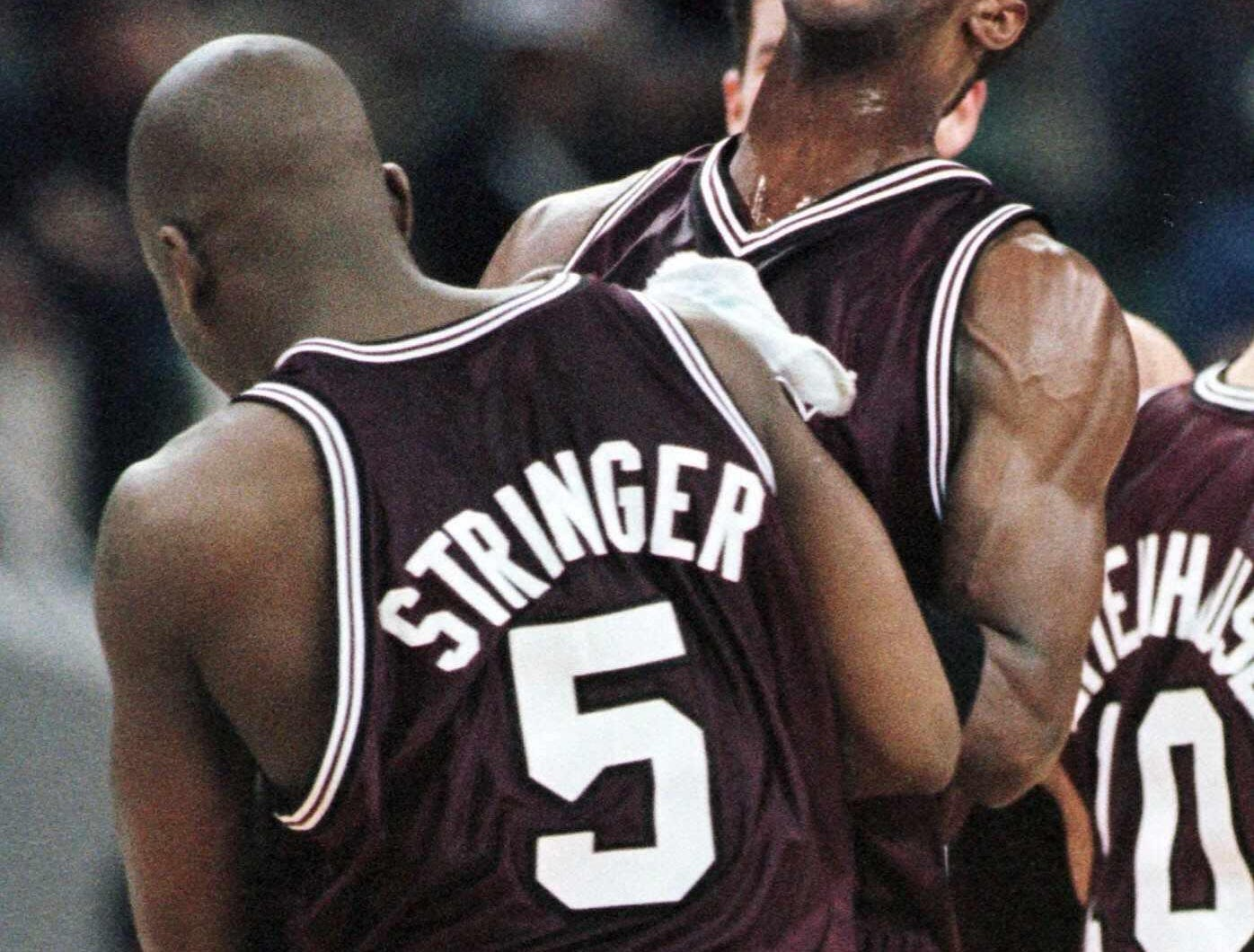 -  -Southwest Missouri State's Allen Phillips, facing camera, celebrates with teammate Ken Stringer (5) after their 81-51 win over Tennessee in the NCAA second round at the Charlotte Coliseum in Charlotte, N.C., Sunday March 14, 1999. (AP Photo/Daniel Hulshizer)