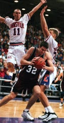 Southwest Missouri State's Danny Moore drives around Evansville's Craig Snow, right, and Jeremy Stanton, left rear, in the first half at Roberts Stadium in Evansville, Ind., Monday, Feb. 22, 1999. (AP Photo/The Evansville Courier & Press, Gary Admire)