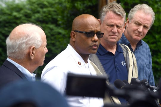 John Butler, center, Fairfax County's new fire chief, speaks at a news conference after floods in Ellicott City, Md., earlier this year. He has worked for almost three years as Howard County's fire chief.