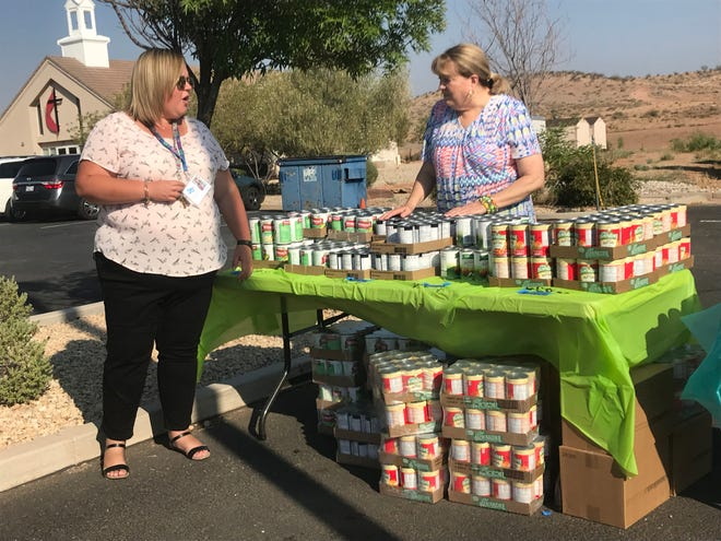 Staffers and volunteers with The Learning Center for Families and the Utah Food Bank gather food to be distributed to TLC clients in St. George on Monday, Aug. 6, 2018.
