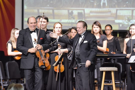 At last year's Summerfest! local students played with the Symphony of the Americas musicians. Maestro James Brooks-Bruzzese is pictured in the center.