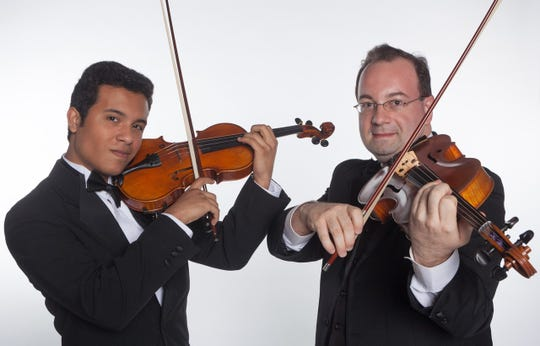Student musician Tomas Lopez with mentor and Concertmaster Carey Moorman.  The Space Coast Symphony Orchestra has three outreach programs for students. The Mentorship program, offers guidance in performance as well as musicianship to student musicians  ages 14 to 22.