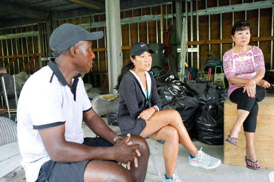 Kela Simunyola with his daughter Kylene Murray and wife Ligaya at the shell of the center's building at the Mount Vernon tennis center on Aug. 6, 2018.