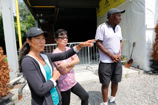 Kylene Murray with her parents Ligaya and Kela Simunyola at the shell of the center's building at the Mount Vernon tennis center on Aug. 6, 2018.