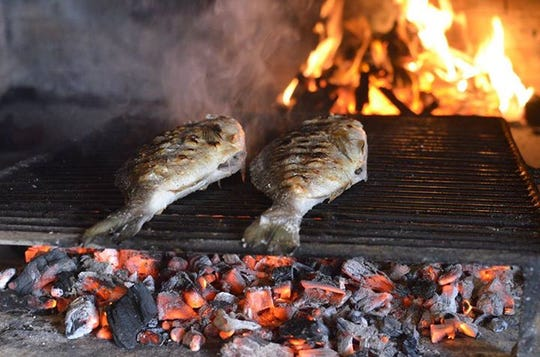 Fresh coastal Mediterranean fish cooked in an open-air authentic Croatian wood-burning oven at Dubrovnik in New Rochelle.