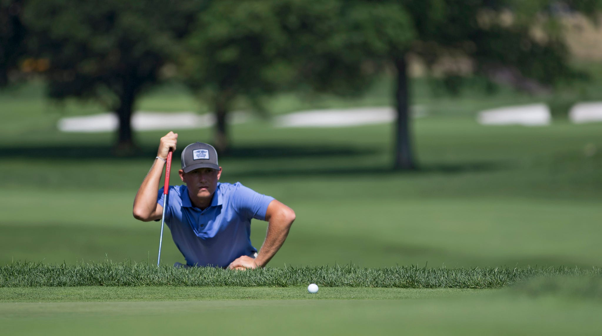 Christian Cavaliere reads the green during the championship match at the 116th Met Am on Sunday at Arcola Country Club.