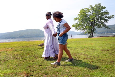 Shantae Mahecha and her daughter, Kelly  Mahecha,10, enjoy a walk at Riverfront Green Park in Peekskill Aug. 3, 2018. Mahecha, a high school teacher and a Peekskill resident, plans to have a Period Party for her daughter.