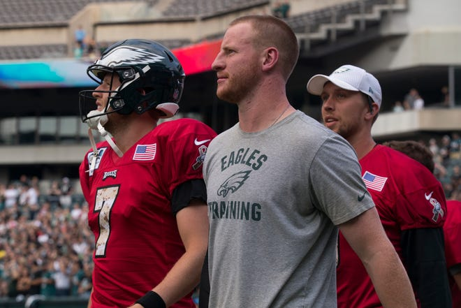 Eagles quarterback Carson Wentz takes the field to practice in front of Eagles fans Sunday at Lincoln Financial Field.