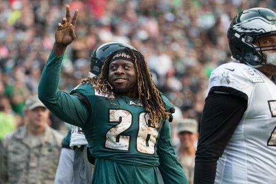 Eagles running back Jay Ajayi (26) waves to fans during the  Eagles' first public practice of the season Sunday at Lincoln Financial Field.
