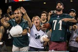 Fans tried their best to get the attention of their favorite football players Sunday night at Lincoln FInancial Field.