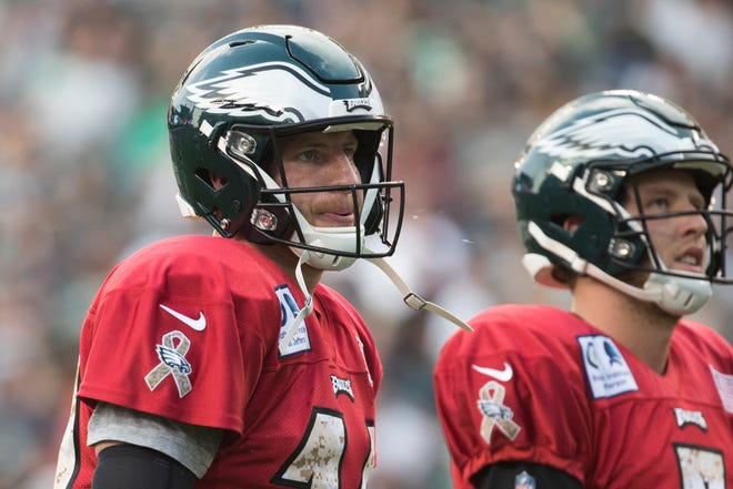 Carson Wentz, left, shown during a recent practice, is still hoping to play in the Eagles' opener on Sept. 6.