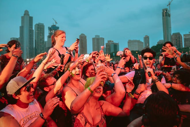The crowd reacts during a Chromeo crowdsurf.