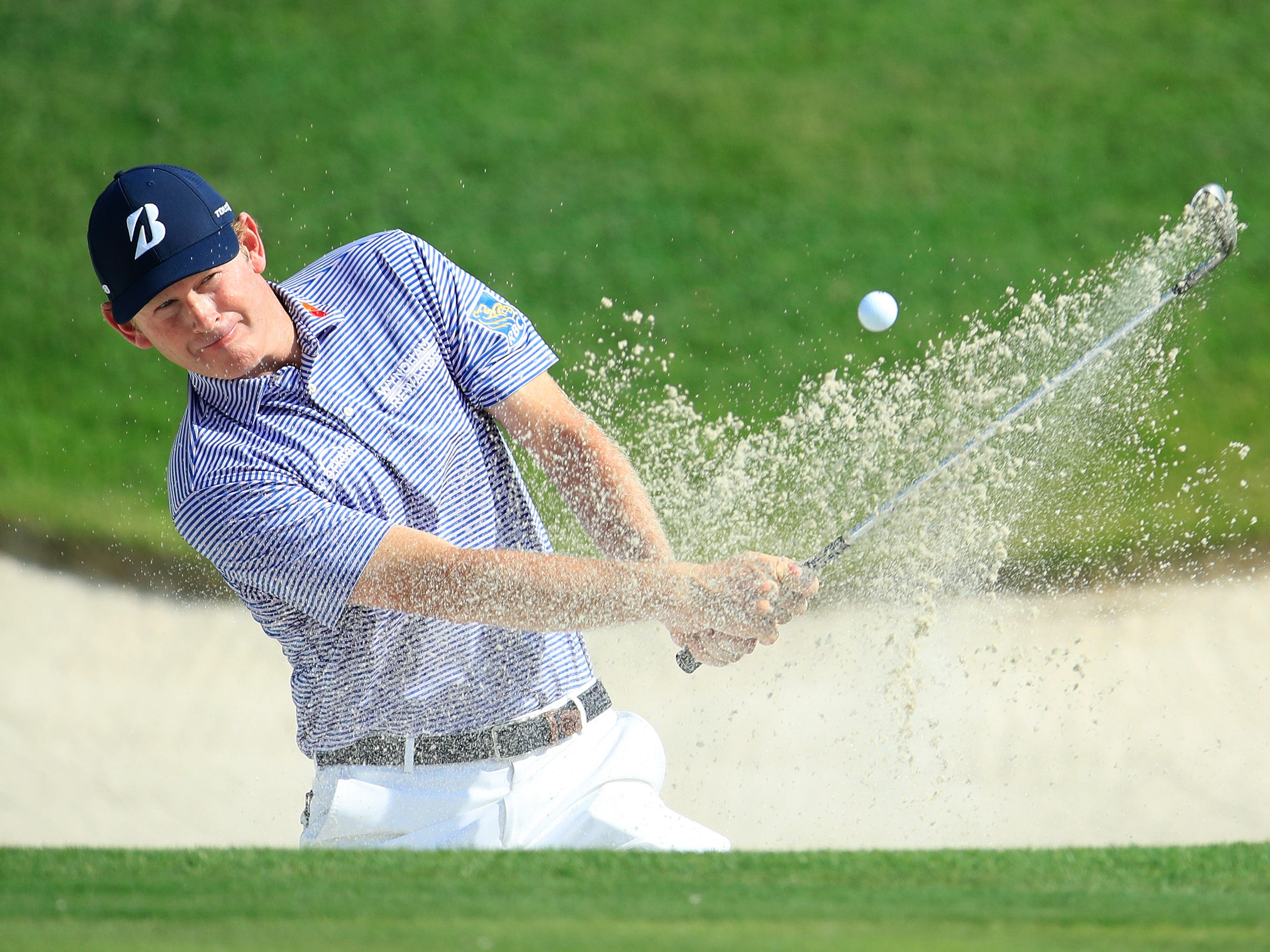 Brandt Snedeker plays a shot from a bunker on the fourth hole.