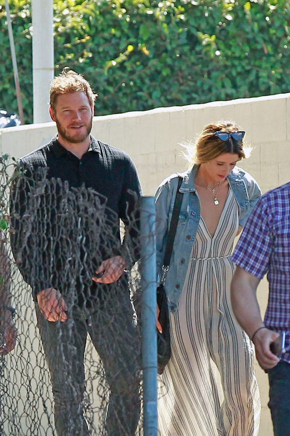 Katherine Schwarzenegger and Chris Pratt walk together after attending church service on Sunday in Los Angeles.