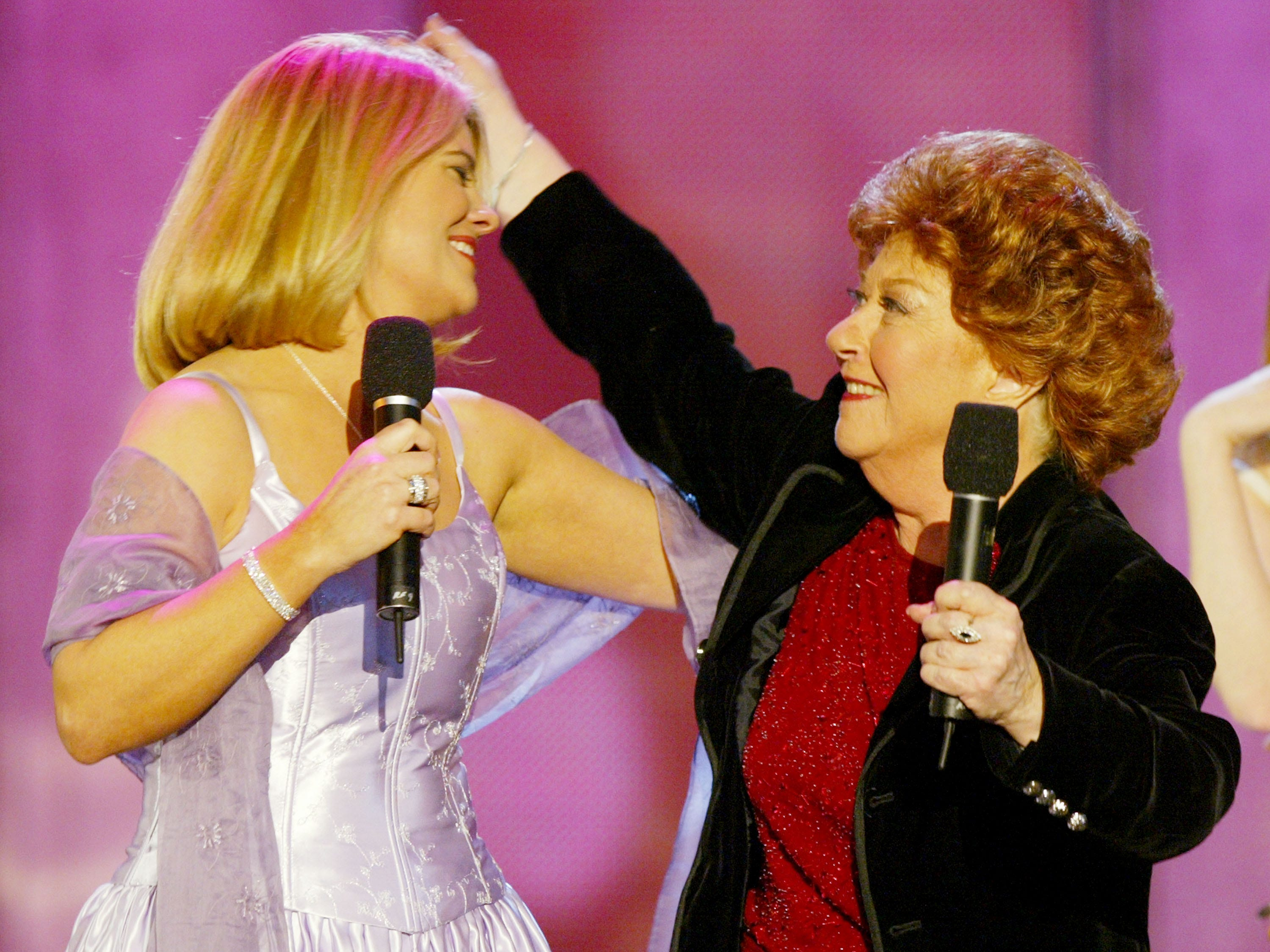 Charlotte Rae, right, and Lisa Whelchel speak on stage at the 2nd Annual TV Land Awards held on March 7, 2004, at The Hollywood Palladium, in Hollywood, Calif.