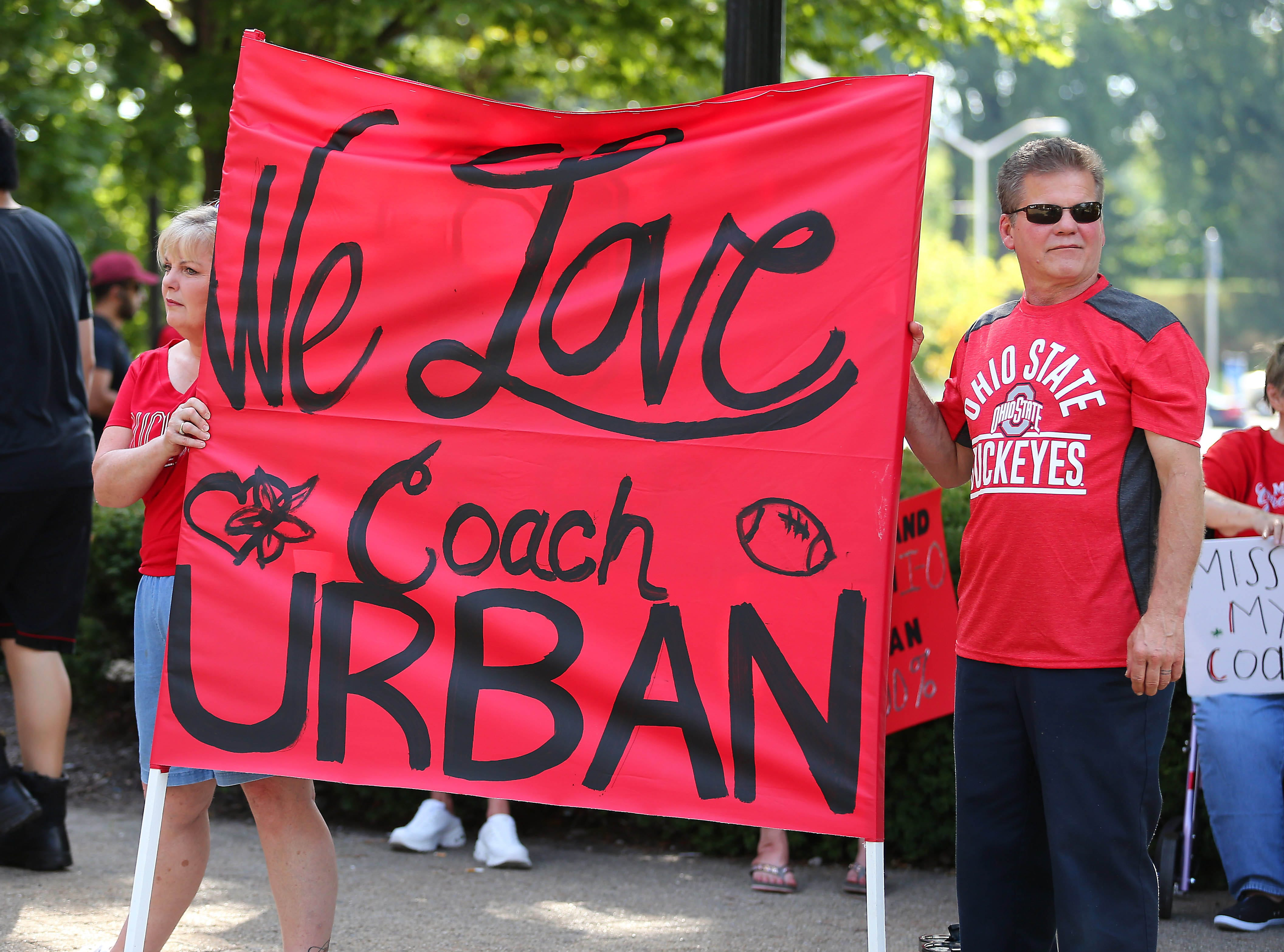 Sue and Gary Baisden of Grove City, Ohio, support Ohio State coach Urban Meyer at a rally held at Ohio Stadium.