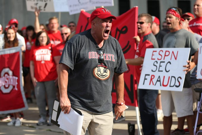 Jeff Hamms leads the rally in support of Ohio State coach Urban Meyer at Ohio Stadium.