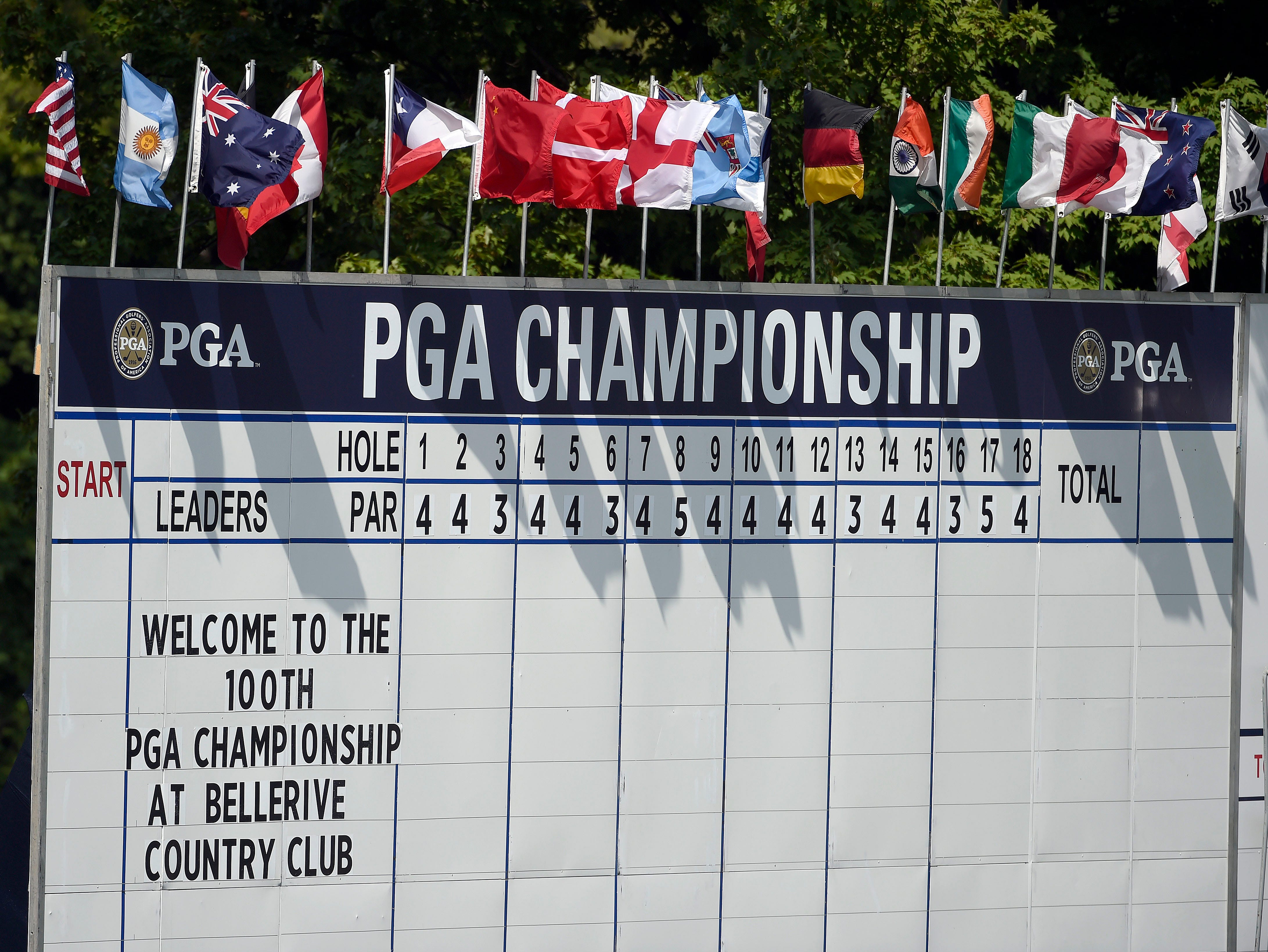 PGA Championship leaderboard greets fans at the 18th green.