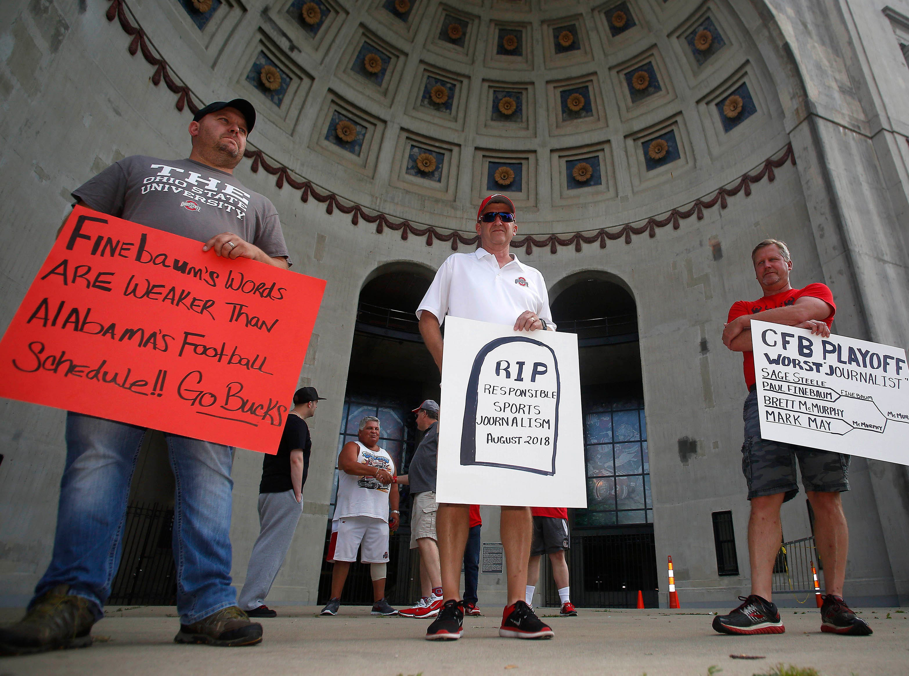 Ed Hathaway, Rick and Chris Haar support Ohio State coach Urban Meyer at a rally held at Ohio Stadium.