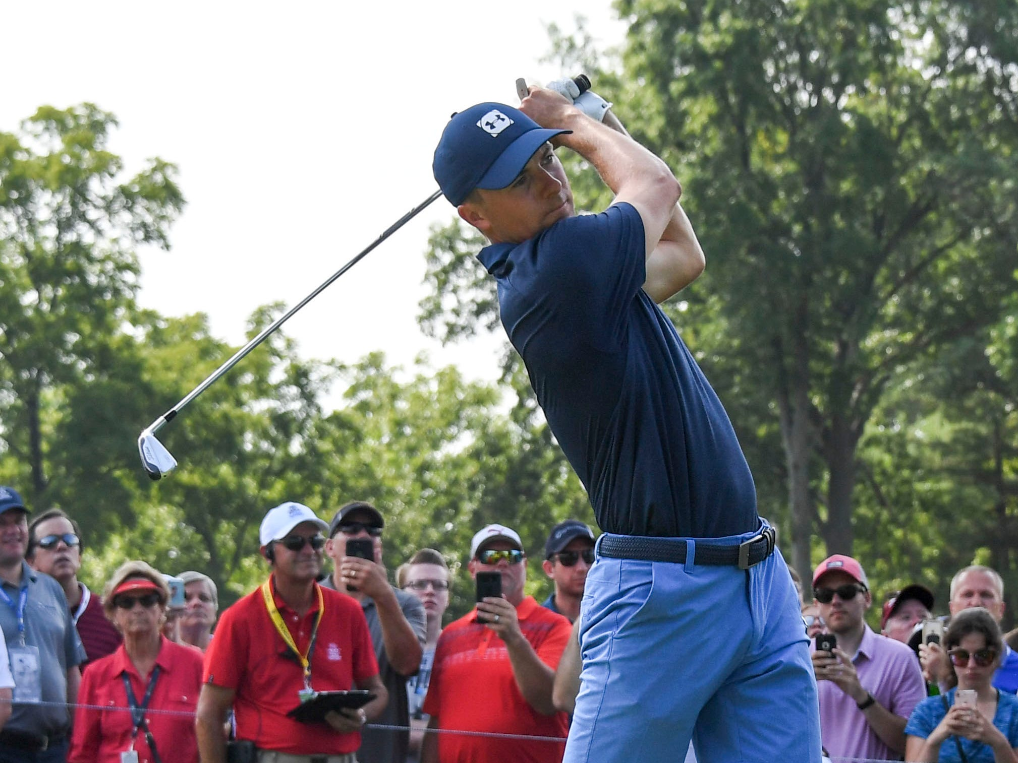 Jordan Spieth hits his tee shot on the sixth hole. Shorts are allowed during practice rounds.