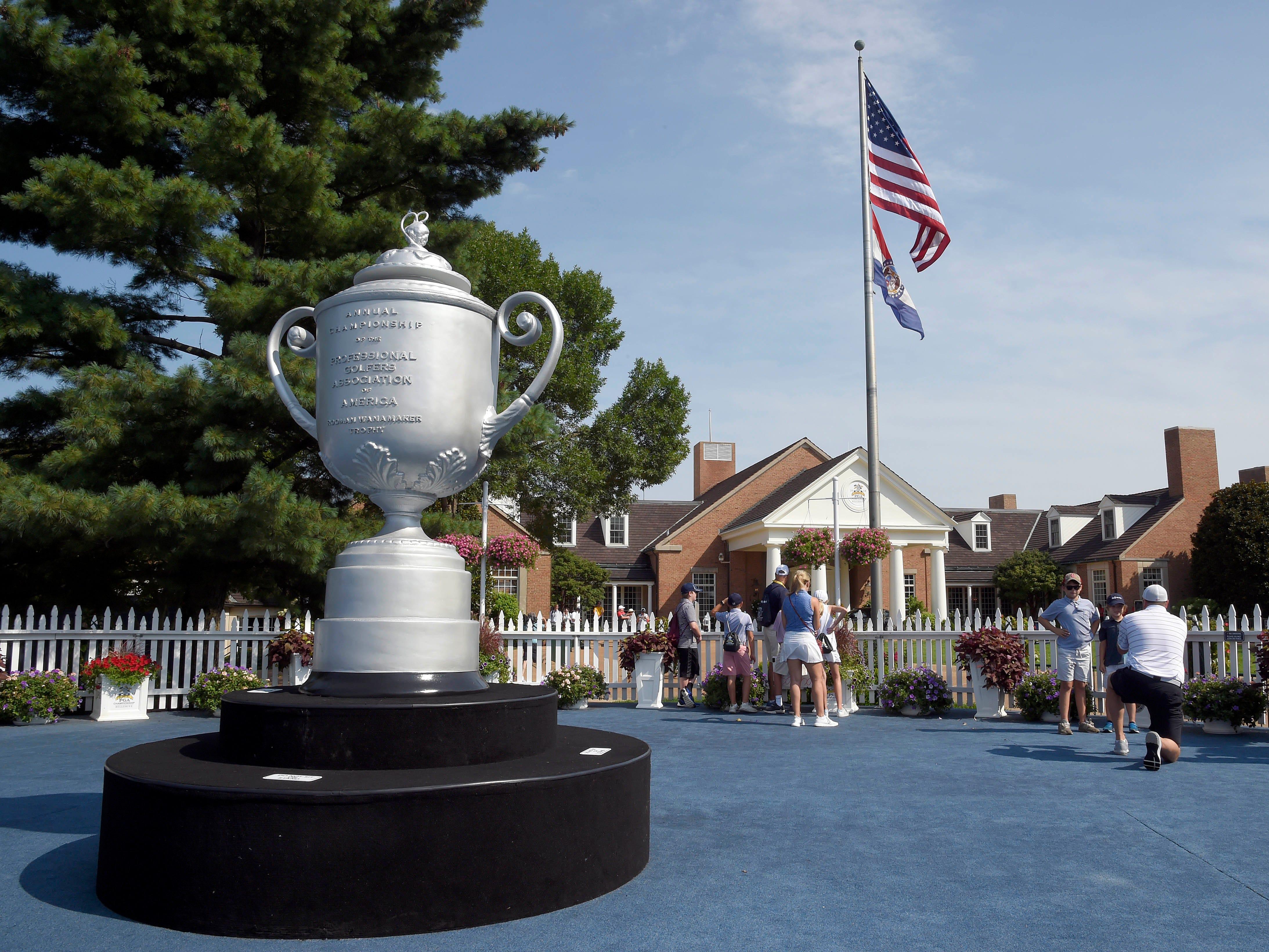An oversized mockup of the Wanamaker Trophy.