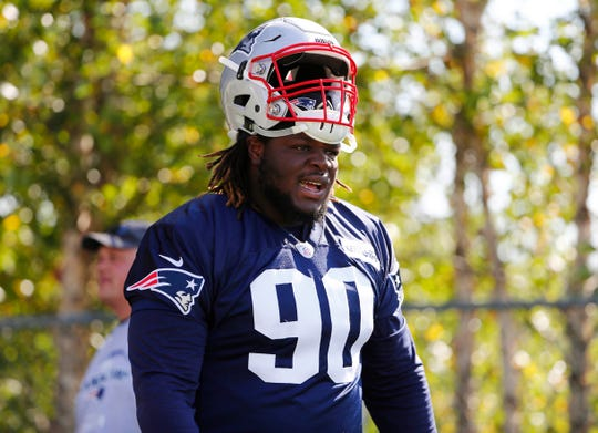 New England Patriots defensive tackle Malcom Brown (90) takes the field for training camp at Gillette Stadium.
