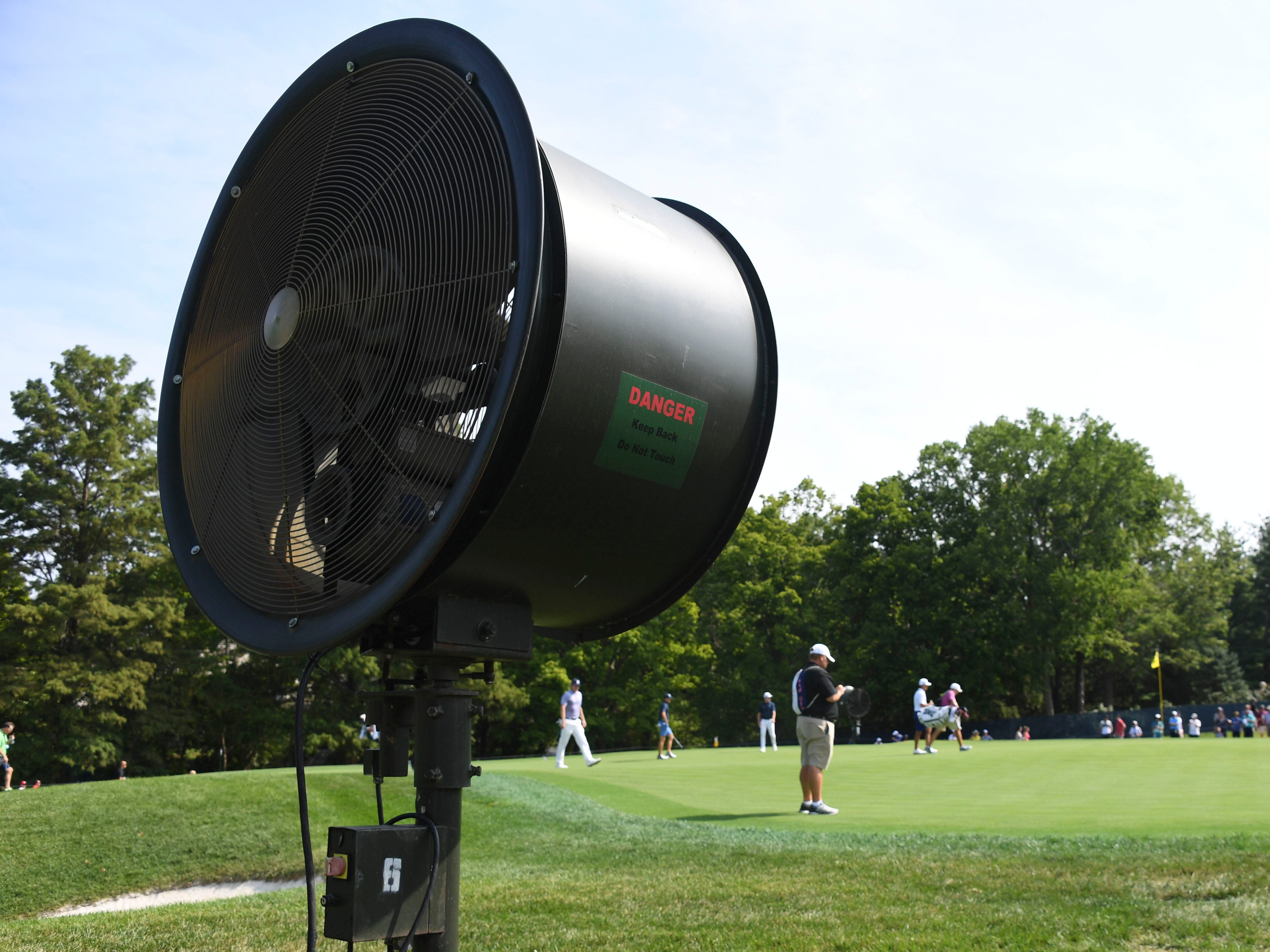 A large fan on the fifth green. Conditions are expected to be warm and muggy this week.
