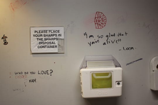 The bathroom at Toronto's supervised injection site is coated in messages.