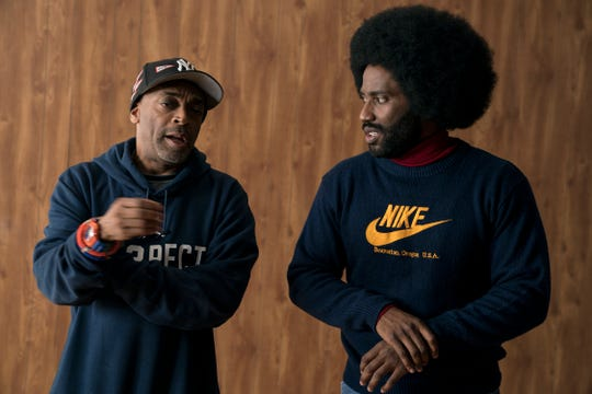 """Director Spike Lee and actor John David Washington on the set of """"BlacKkKlansman,"""" a Focus Features release."""